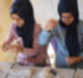 Syrian women working on beading project