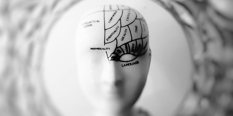 Sculpture on a head with writing on