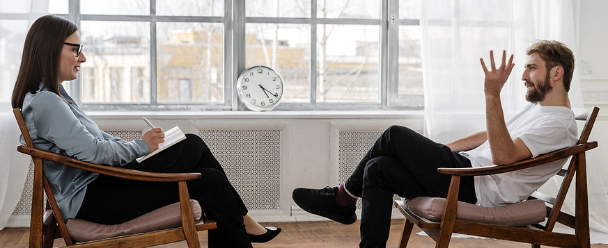 Man and woman sat having counselling session