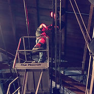 One of our Daring Light riggers busy at work on a lift.