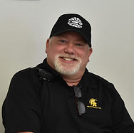 A photograph of Mark Solum smiling at the camera