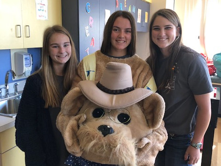 Beta Club Members Distribute Bears at Blair E. Batson