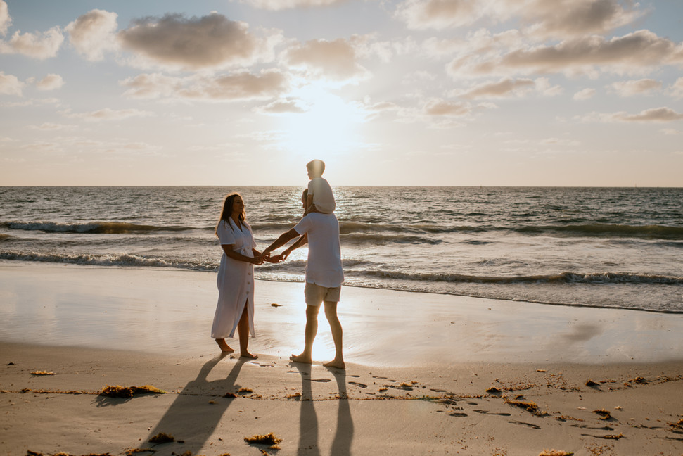 Golden sunset maternity session at beach
