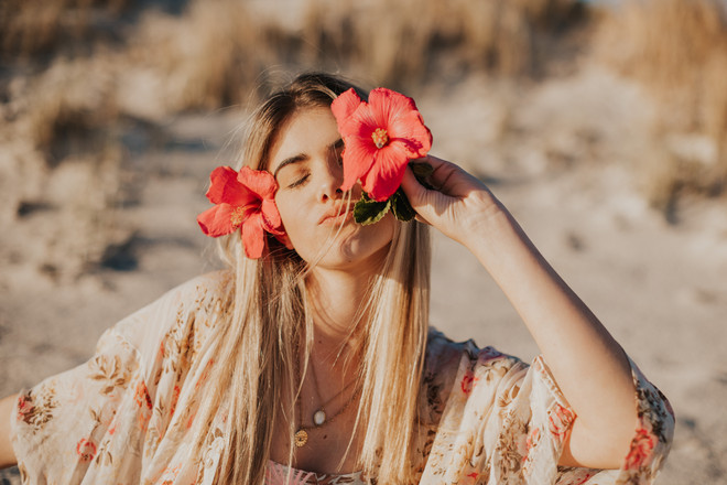 Girl with hibiscus flowers