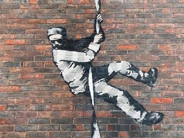 Banksy showt nieuwste kunstwerk in een making-of video met voice-over van Bob Ross (video)