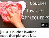 image montrant une main et une couche lavable faisant le lien vers une vidéo YouTube d'Athena Cassy faisant un test des couches lavables Applecheeks