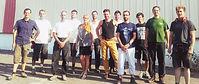 Photo de groupe de l'équipe de la scop Bati-Nature faisant le lien vers le site internet de l'entreprise