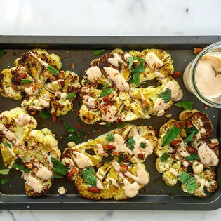 Cauliflower steaks with harrisa yoghurt