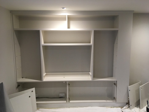Matching colour to walls really makes this bespoke unit a seamless piece