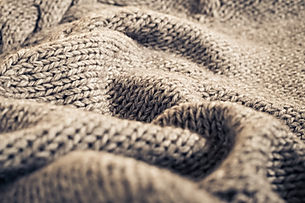 Knitted fabric wool texture close up as
