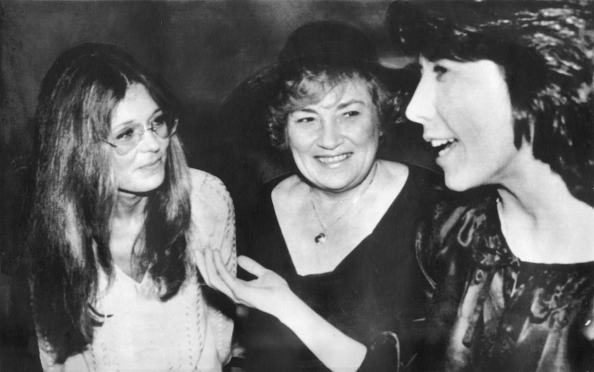 Feminist activists Gloria Steinem and Bella Abzug with actor Lily Tomlin in 1977