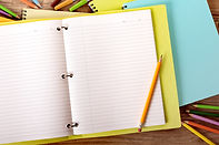 an open notebook and pencil