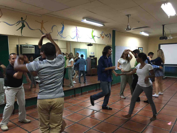 students learning to dance salsa in our