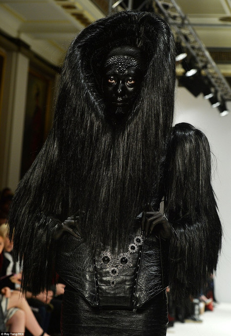 White catwalk models covered with black paint