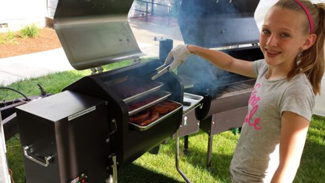 Young Girl Happy using a BBQ Smoker Tray