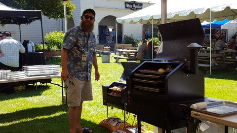 Man enjoying Bull Rack BBQ Grill Tray System