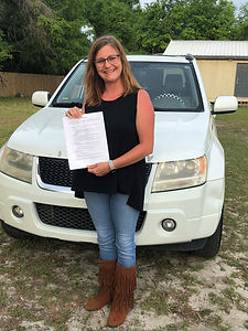 Aliisa with Rental Agreement and Car.jpg