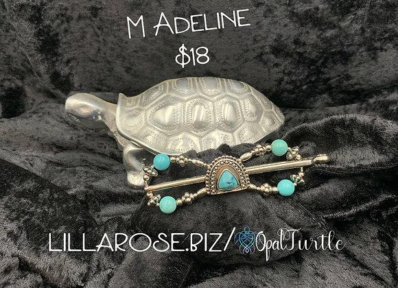 Adeline M