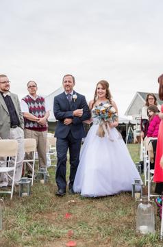 Dad Walks Bride down Aisle.png