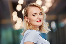 Photo of Kinga Gruszecka. Blurred background.