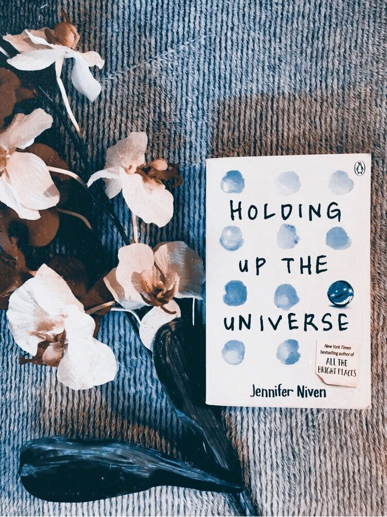"""If you're a fan of romantic books, I recommend you reading this one 💙 """"Holding up the universe"""" #books #bookstagram #booklovers #reading"""