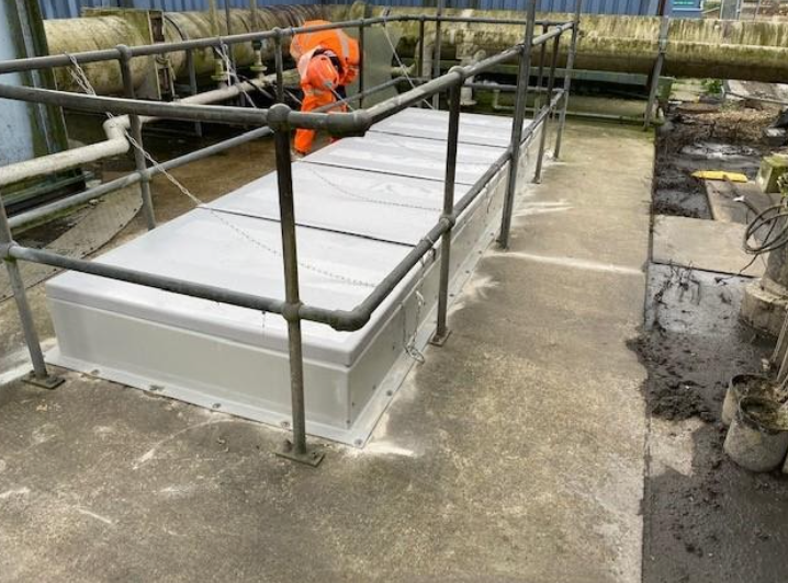 The client needed weatherproof covers over apertures in a concrete slab that were used to remove large pumps from a dry-well. The covers consisted of lightweight hinged panels mounted on a GRP upstand that were easily operated from behind the safety handrailing.