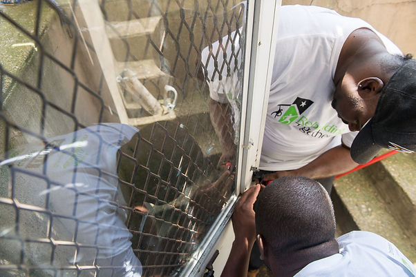 Volunteers_Male_Fixing Door.jpg