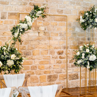 Gold Rectangular Archway With gold Gloral Stands and Silk Floral Arrangements
