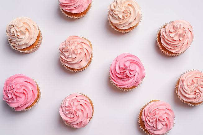 Many yummy cupcakes on white background.jpg