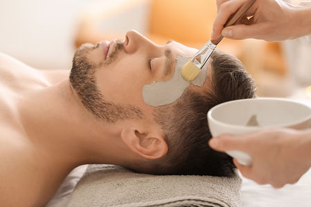 Cosmetologist applying cosmetic mask on