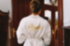 a woman in a white bathrobe with the wor