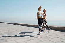 Due Ragazze jogging by Water