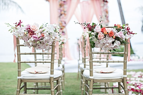 Chivari Chairs with beautiful flowers designed for a wedding ceremony