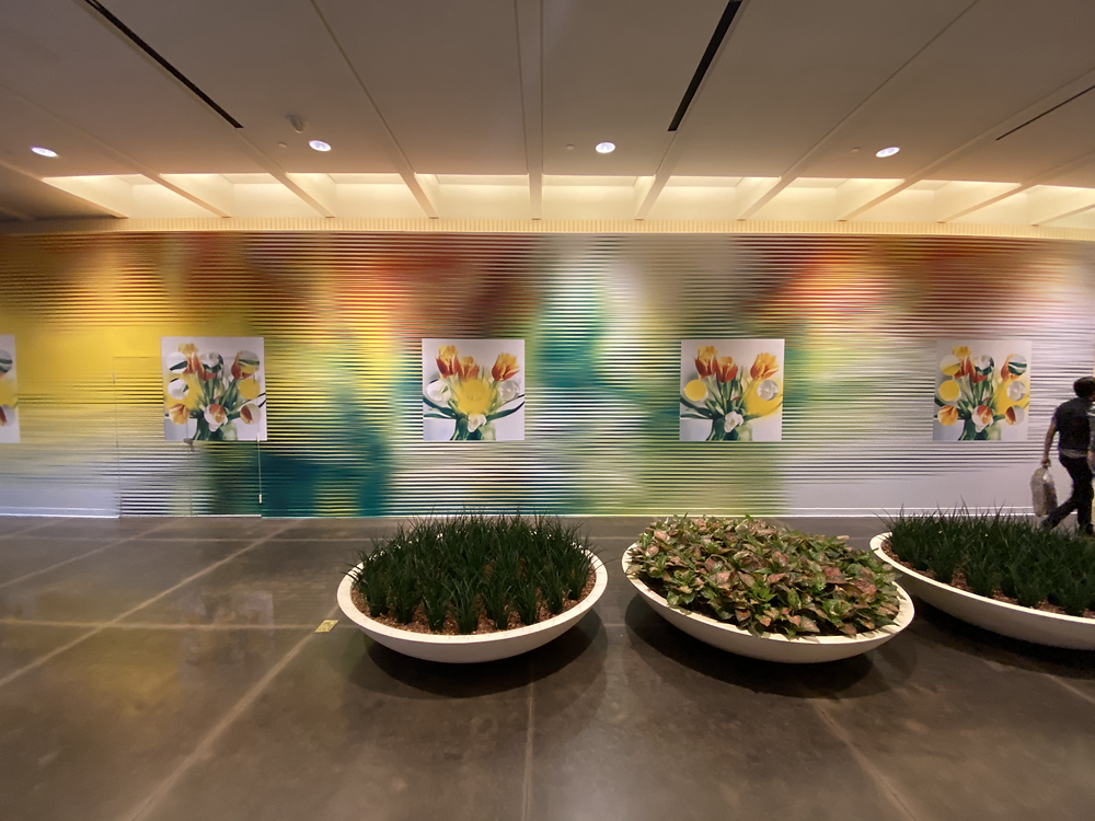 glitched paintings of yellow, orange and green flower bouquets