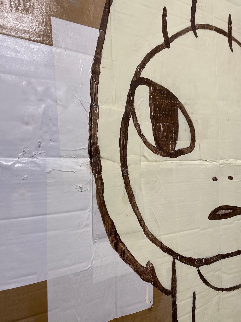 Detail shot of Yoshimoto Nara painting on cardboard