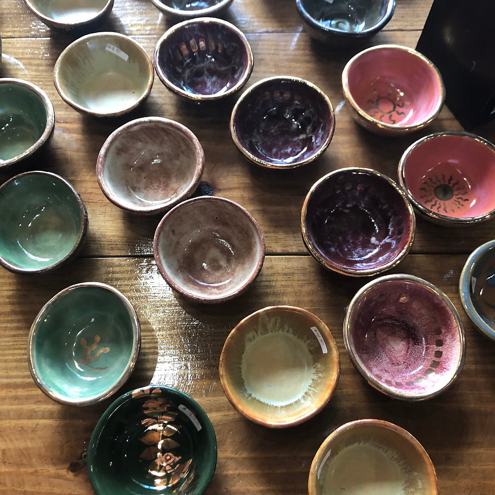 small colorful bowls in green, beige, purple and rose.
