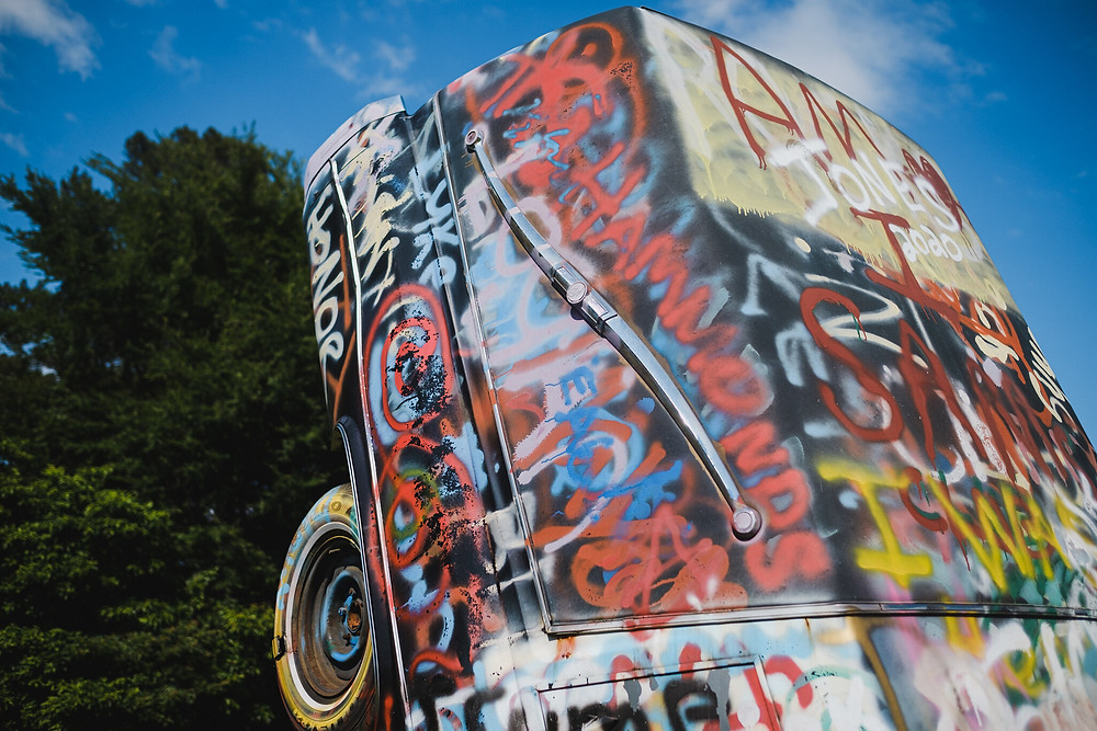 details of graffiti art on a car