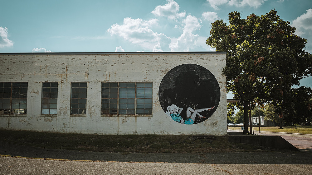 Mural with a female figure in circle.