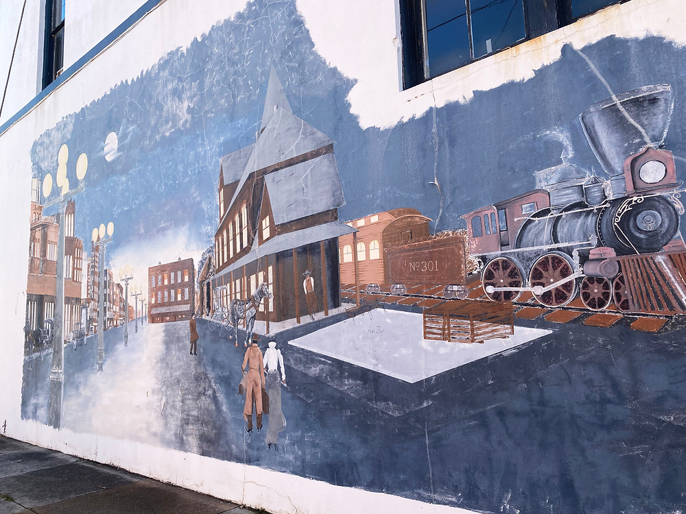 Mural of a train and depot.