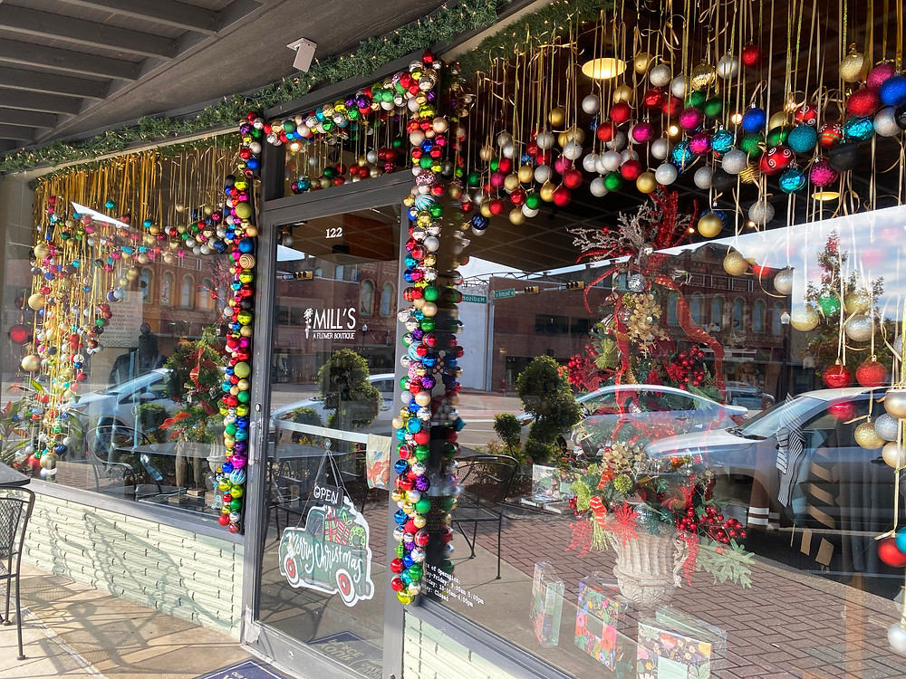 Christmas ornament and tinsel streamers in a downtown Mount Pleasant Texas Storefront.