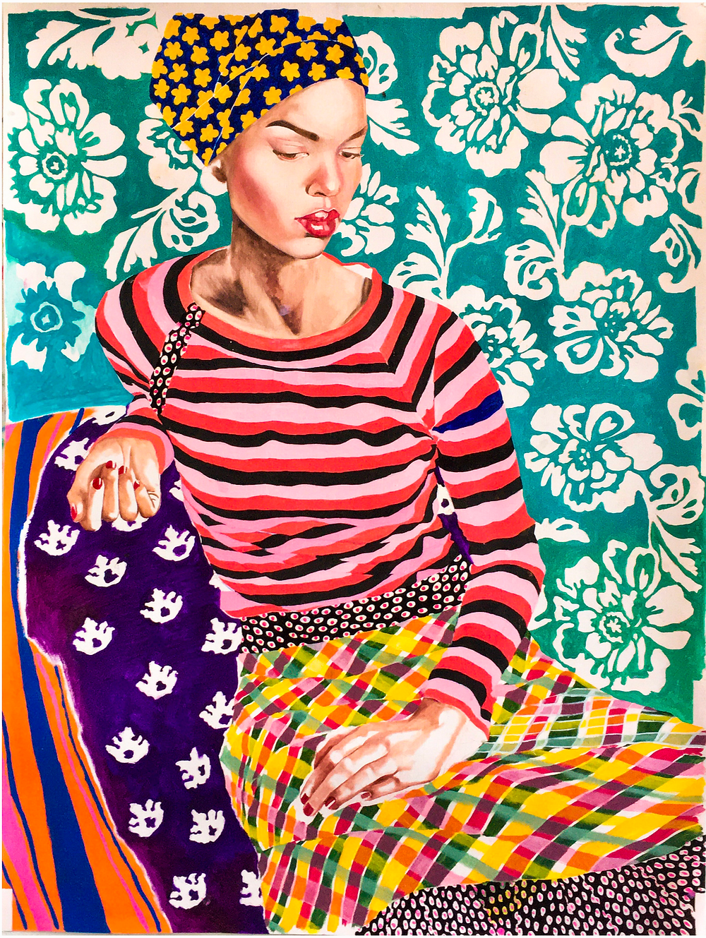 portrait of dark skinned girl in colorful patterned clothes and head wrap