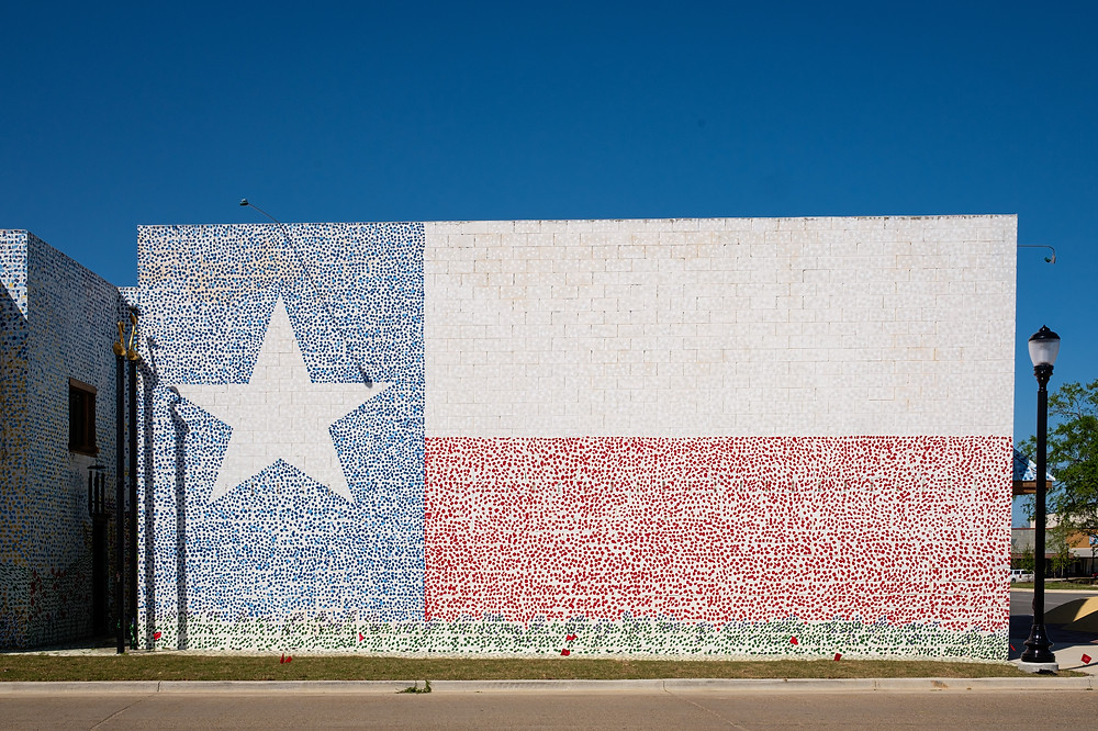 Art Gallery with Texas flag painted on the side.