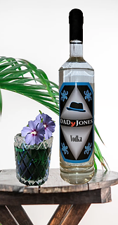 cocktail called Green Bayou with bottle of DADyJones vodka on a table
