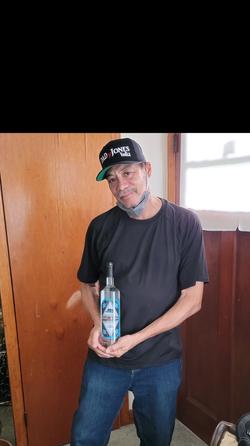MR. CLYDE holding bottle