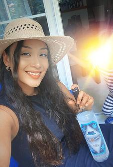 Krissy smiling holding bottle