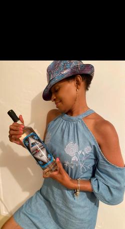 MS KING holding bottle