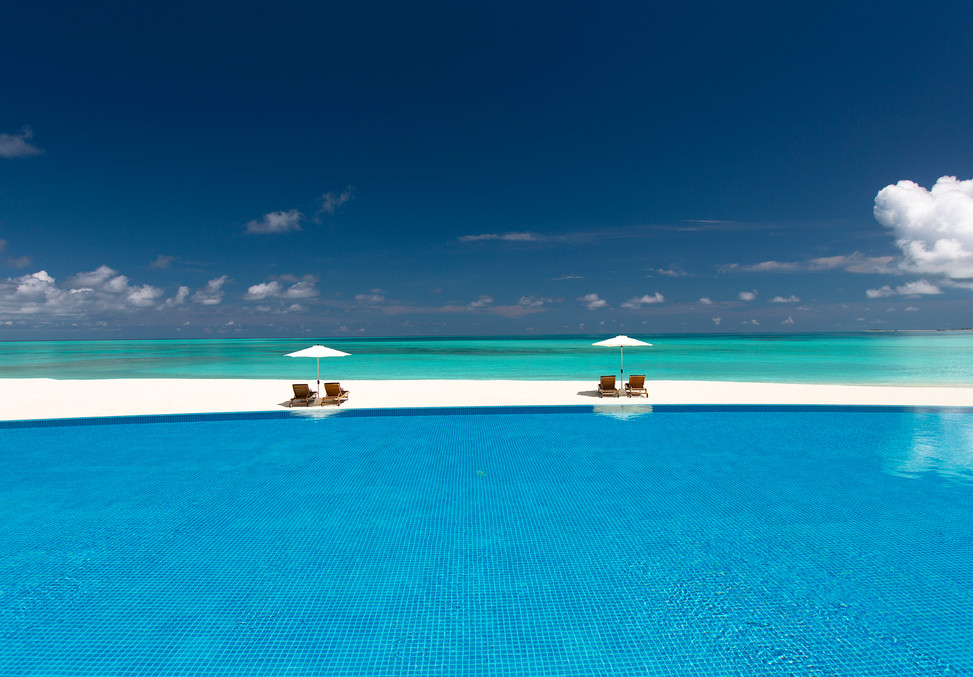 THE SUNSET - POOL VIEW AND LOUNGERS.jpg