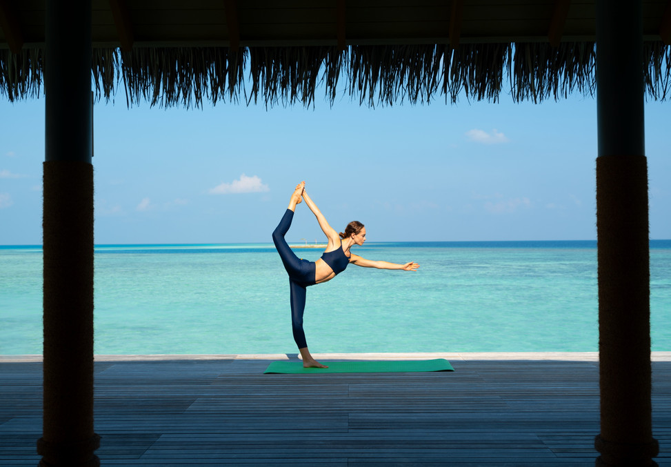 Yoga at the overwater gym deck.JPG