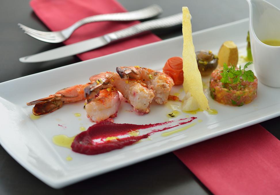 FOOD SHOT - Grilled King prawns served w