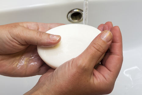 African American woman washing hands, is